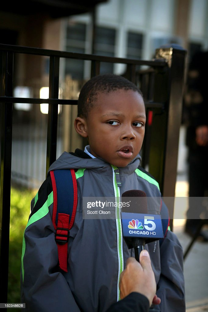 Camren Jenkins gets interviewed by a local television reporter as he waits outside of Frazier International Magnet School before the start of school on September 19, 2012 in Chicago, Illinois. Today was the first day back at school for about 350,000 Chicago public school children after more than 26,000 teachers and support staff walked off of their jobs on September 10 after the Chicago Teachers Union failed to reach an agreement with the city on compensation, benefits and job security.
