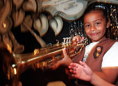 CAMusicTrumpetRDL Rosalyn Gonzalez of Norwalk checks out a trumpet at the 'The Music Studio' exhibit at the Children's Museum at La Habra TIMES