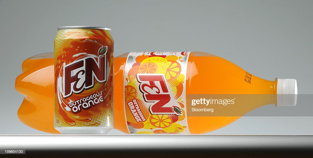 A can and a bottle of Fraser & Neave Ltd.'s F&N Outrageous Orange sparkling drink is arranged for a photograph in Singapore, on Monday, Jan. 21, 2013. Thailand's richest man came closer to winning control of Fraser & Neave after a rival group failed to top his S$13.8 billion ($11.2 billion) offer for the 130-year-old property and beverage company. Photographer: Munshi Ahmed/Bloomberg via Getty Images
