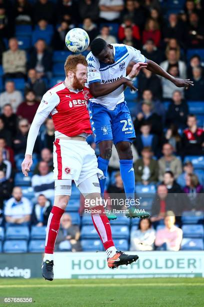 Can Bolger of Fleetwood Town and Leon Barnett of Bury during the Sky Bet League One match between Bury and Fleetwood Town at Gigg Lane on March 25...