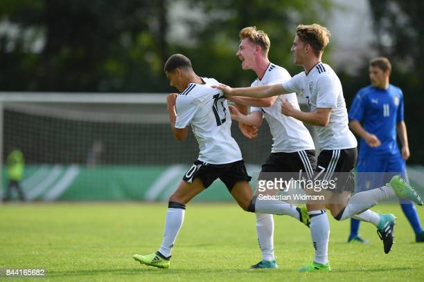 Can Bozdogan of Germany celebrates his teams first goal with teammates Niclas Knoop and Ole Pohlmann during the Four Nations Tournament match between...