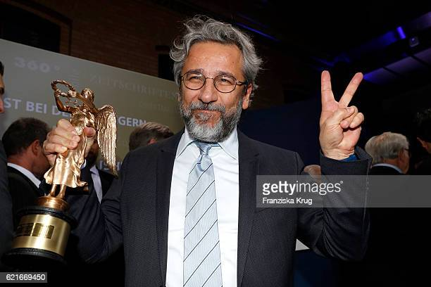 Can Duendar poses with his award for 'Freedom of the press' during the VDZ Publishers' Night 2016 at Deutsche Telekom's representative office on...