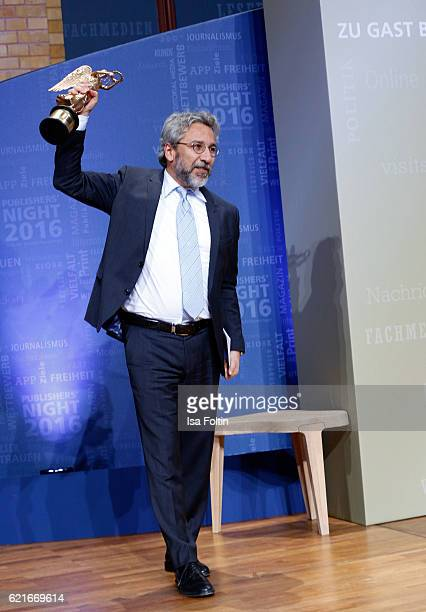 Can Duendar poses with his award for freedom of the press during the VDZ Publishers' Night 2016 at Deutsche Telekom's representative office on...