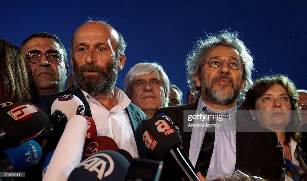Can Dundar (2nd R), editor-in-chief of the newspaper Cumhuriyet, and Erdem Gul (2nd L), the papers Ankara bureau chief, speak to the media outside the Istanbul's Caglayan courthouse after the court announced its decision in Istanbul, Turkey on May 06, 2016. A high court in Istanbul convicted Turkish journalists Can Dundar and Erdem Gul Friday night on charges of revealing state secrets, sentencing them to five years and 10 months, and five years in prison, respectively.