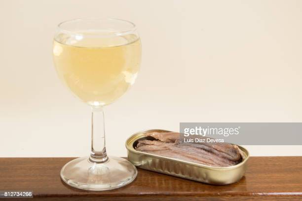 can of  anchovies  in olive oil and cup white wine