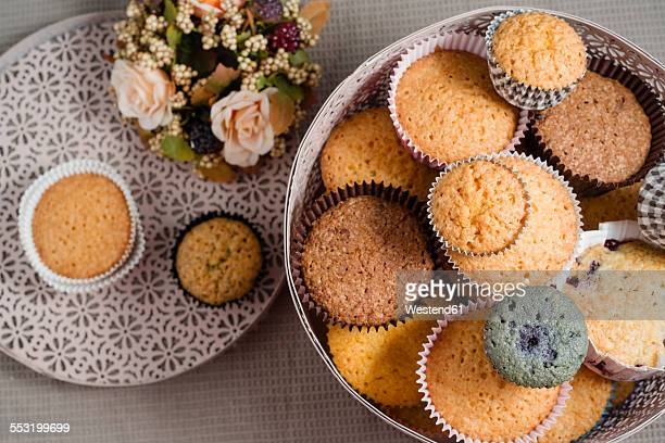 Can of different home-baked cup cakes