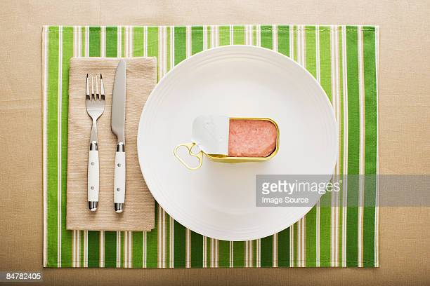 A can of ham on a plate