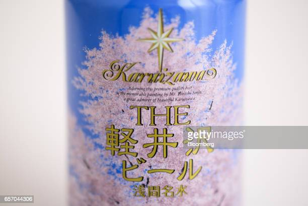A can of Karuizawa Brewery Ltd's cherry blossom themed Oukaranman beer is arranged for a photograph in Kawasaki Kanagawa Japan on Wednesday March 22...