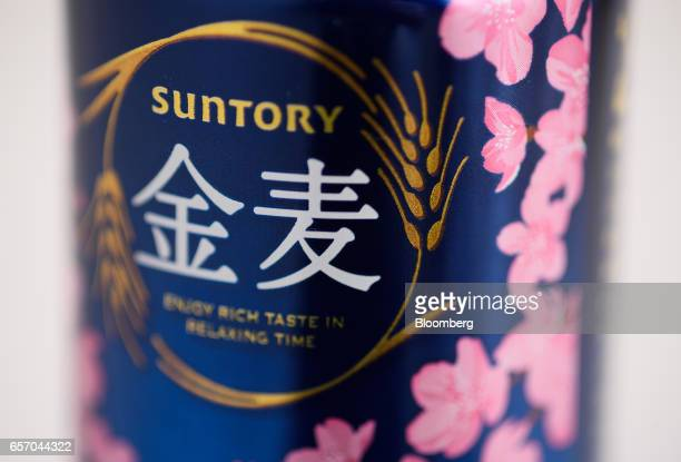 A can of Suntory Beer Ltd's Kinmugi brand cherry blossom themed happoshu is arranged for a photograph in Kawasaki Kanagawa Japan on Wednesday March...