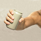 Close-up of an empty can in a strong hand.