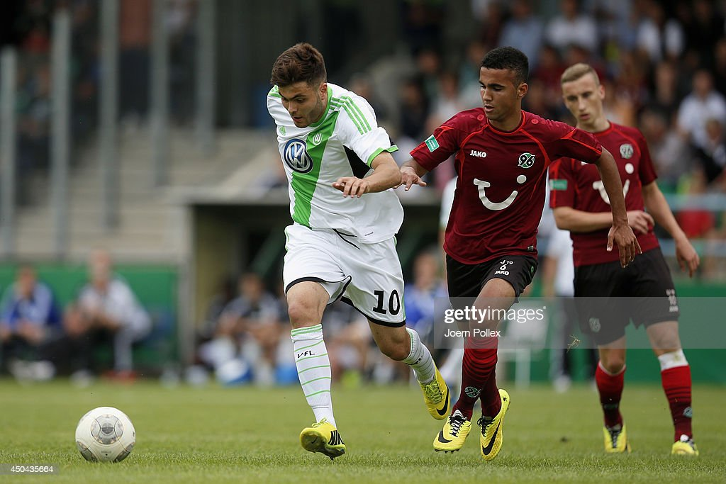Can Tuna (L) of Hannover and Kerem Buelbuel of Wolfsburg compete for the ball during the A Juniors Bundesliga Semi Final at Beekestadium on June 11, 2014 in Hanover, Germany.