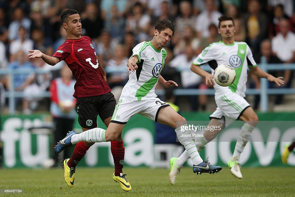 Can Tuna (L) of Hannover and Orkan Cinar of Wolfsburg compete for the ball during the A Juniors Bundesliga Semi Final at Beekestadium on June 11, 2014 in Hanover, Germany.