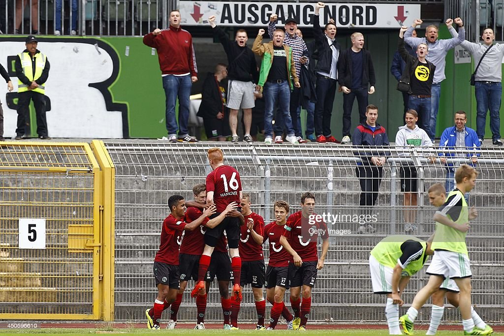 Can Tuna, scorer Kevin Krottke, Lukas Wilton, Noah Sarenren-Bazee, Mike Steven Baehre, Niklas Teichgraeber and Fynn Arkenberg of Hannover celebrate in front of the fans during the A Juniors Bundesliga Semi Final between U19 VfL Wolfsburg and U19 Hannover 96 at Stadion am Elsterweg on June 14, 2014 in Wolfsburg, Germany.