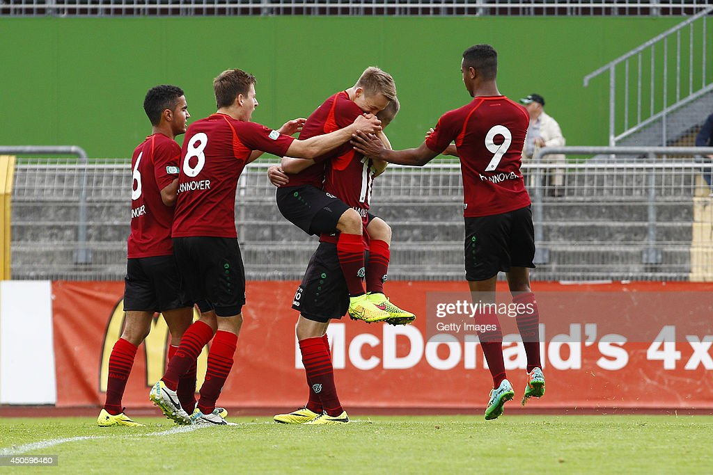Can Tuna, Waldemar Anton, Marc-Jannick Grunert, scorer Mike Steven Baehre and Noah Sarenren-Bazee of Hannover celebrate the 1:1 during the A Juniors Bundesliga Semi Final between U19 VfL Wolfsburg and U19 Hannover 96 at Stadion am Elsterweg on June 14, 2014 in Wolfsburg, Germany.