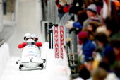 Canada 1 piloted by Lyndon Rush crosses the finish line in the second run of the 4man bobsled competition during the FIBT Bob Skeleton World Cup on...
