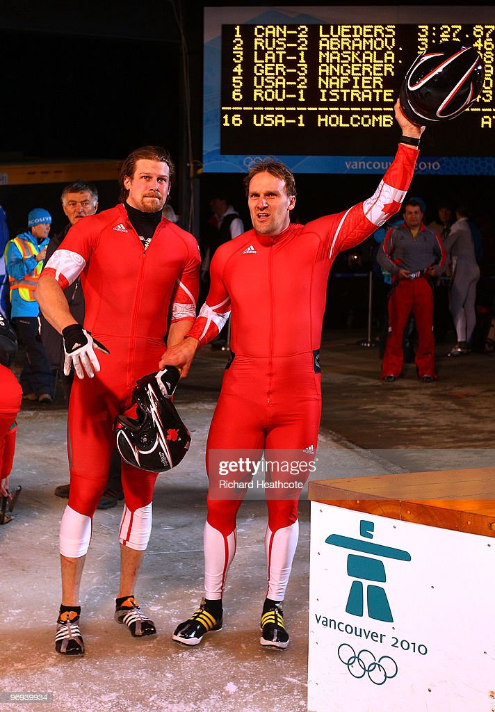 Canada 2 with <a gi-track='captionPersonalityLinkClicked' href=/galleries/search?phrase=Pierre+Lueders&family=editorial&specificpeople=211058 ng-click='$event.stopPropagation()'>Pierre Lueders</a> and Jesse Lumsden (L) celebrate after the Two-Man Bobsleigh Heat 4 on day 10 of the 2010 Vancouver Winter Olympics at the Whistler Sliding Centre on February 21, 2010 in Whistler, Canada.