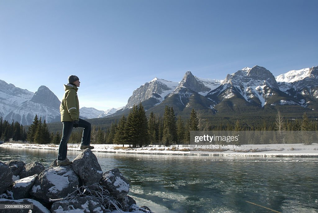 Canada, Alberta, Canmore, woman beside Bow River, side view : Stock Photo
