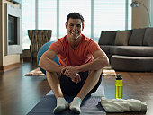 Canada, Alberta, portrait of young man exercising at home