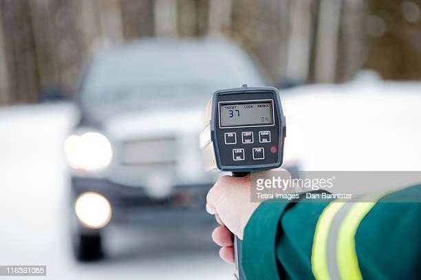 Canada, Alberta, Traffic officer holding speed gun