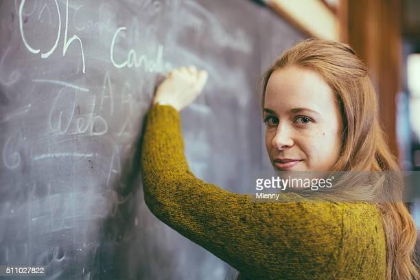 O Canada Anthem, Female student writing at chalkboard