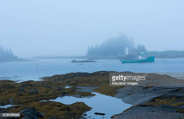 Canada Blue Rocks Nova Scotia fog thick foggy with boats and fishing houses small village