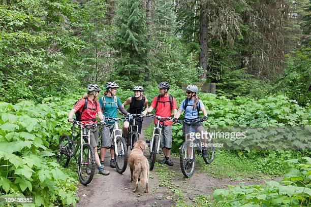 Canada, British Columbia, Fernie, Group of five people and dog enjoying mountain biking