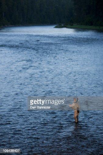 Canada british columbia fernie man fly fishing in river for British columbia fishing license