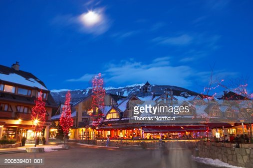 Canada, British Columbia, moon over Whistler Village at dusk : Stock Photo