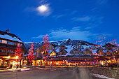 Canada, British Columbia, moon over Whistler Village at dusk