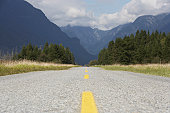Canada, British Columbia, Pitt Meadows, rural road leading to mountains, ground view