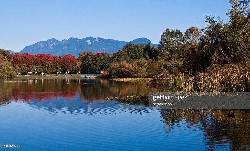 Canada, British Columbia, Vancouver, Mountains and Trout lake in autumn