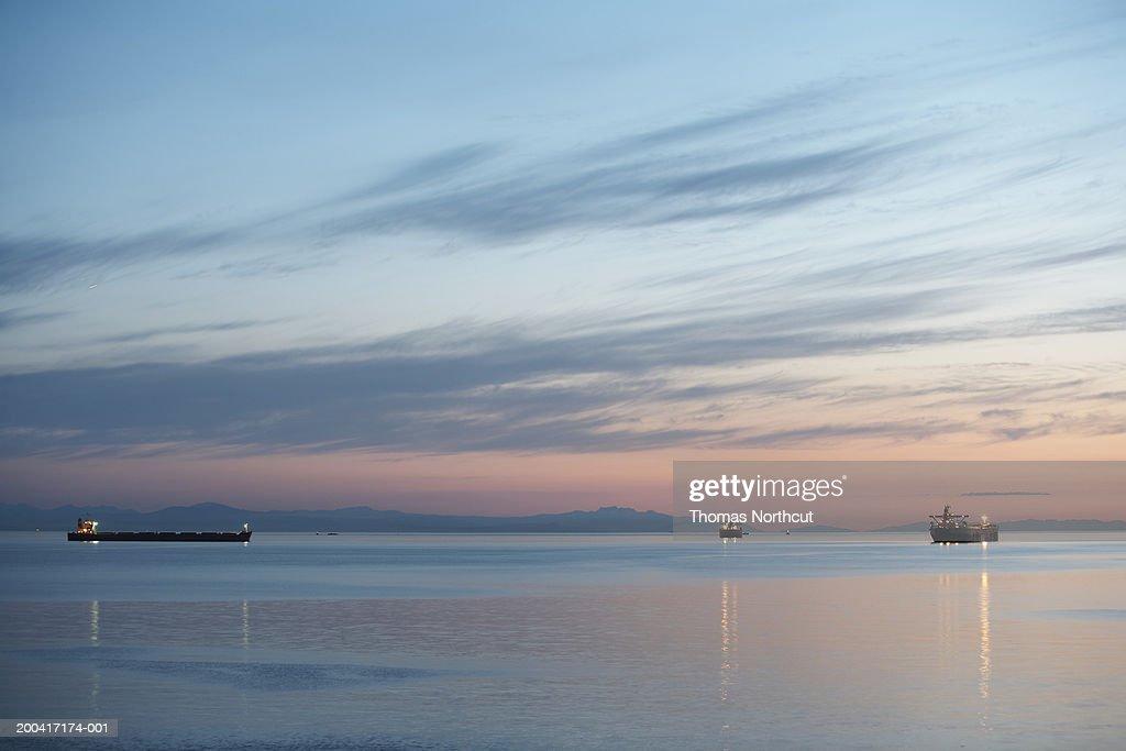 Canada, British Columbia, Vancouver, ships in English Bay at dusk : Stock Photo