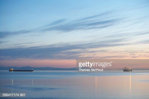 Canada, British Columbia, Vancouver, ships in English Bay at dusk : Stock Photo