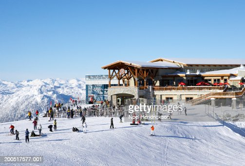 Canada, British Columbia, Whistler, people outside ski lodge