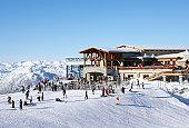 Canada, British Columbia, Whistler, people outside ski lodge