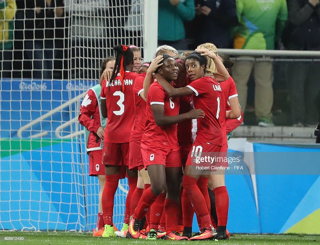Canada celebrate after they defeated France during the Women's Football Quarter Final match between Canada and France on Day 7 of the Rio 2016 Olympic Games at Arena Corinthians on August 12, 2016 in Sao Paulo, Brazil.