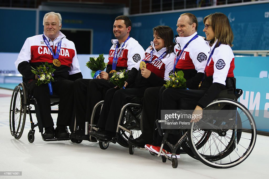 Canada celebrate after winning the gold medal match between Russia and Canada on day eight of Sochi 2014 Paralympic Winter Games at the Ice Cube Curling Center on March 15, 2014 in Sochi, Russia.