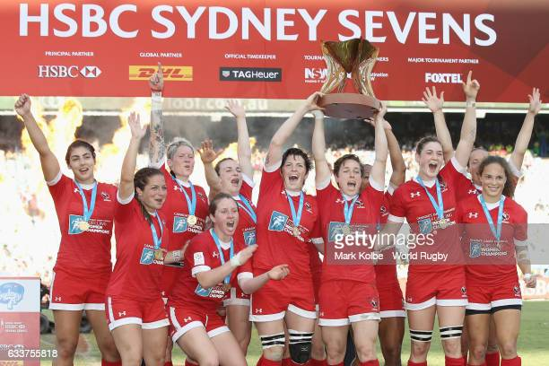 Canada celebrate victory with the trophy after victory during the womens cup final match between USA and Canada in the 2017 HSBC Sydney Sevens at...