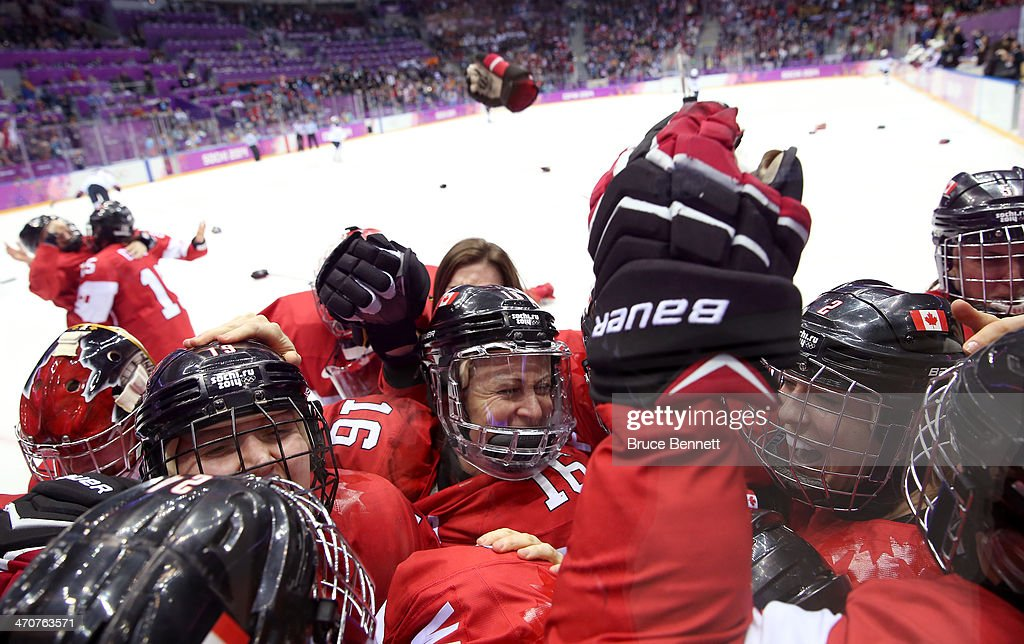 Canada celebrates after Marie-Philip Poulin #29 scored the game-winning goal against the United States in overtime during the Ice Hockey Women's Gold Medal Game on day 13 of the Sochi 2014 Winter Olympics at Bolshoy Ice Dome on February 20, 2014 in Sochi, Russia.