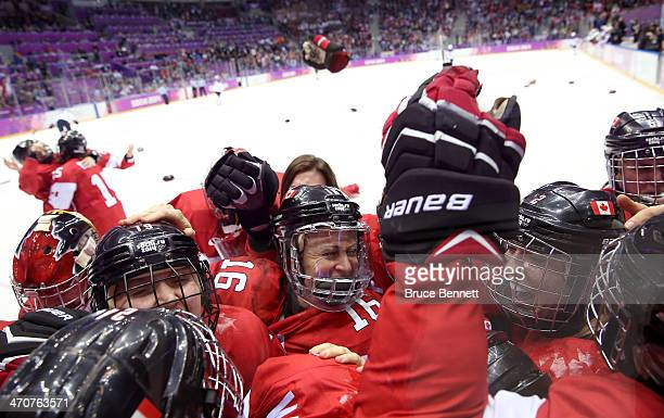Canada celebrates after MariePhilip Poulin scored the gamewinning goal against the United States in overtime during the Ice Hockey Women's Gold Medal...