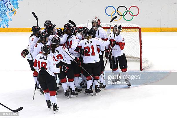 Canada celebrates after winning the game during the Women's Ice Hockey Playoffs Semifinal game 31 against Switzerland on day ten of the Sochi 2014...