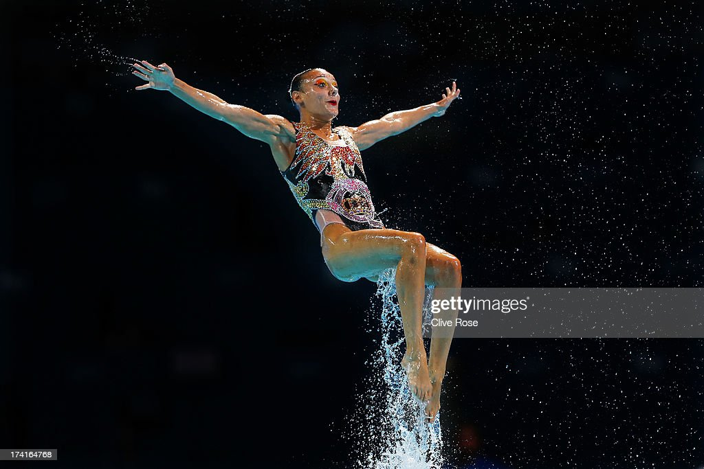 Canada compete in the Synchronized Swimming Free Combination preliminary round on day two of the 15th FINA World Championships at Palau Sant Jordi on...