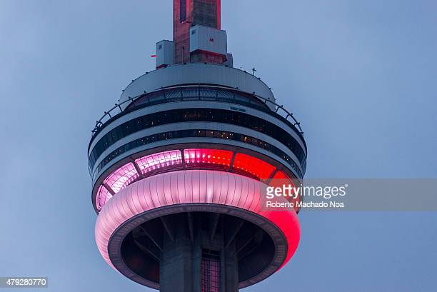 SQUARE TORONTO ONTARIO CANADA Canada Day celebrations in Toronto CN tower lit in red and white the colors of the flag of Canada during the...