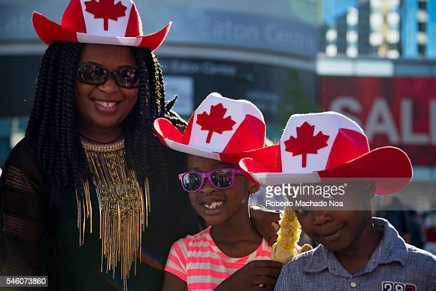 Canada Day people Afro American family enjoying the 149th Canada Day celebration