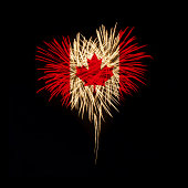 Fireworks in a heart shape with the Canada flag on a black background. Canada day. Welcome to Canada