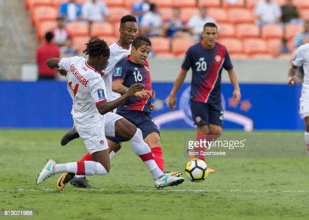 Canada defender Samuel Adekugbe and Costa Rica defender Christian Gamboa fight for ball during the CONCACAF Gold Cup Group A match between Costa Rica...