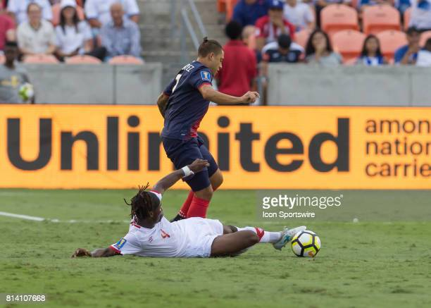 Canada defender Samuel Adekugbe slide tackles to clear the ball during the CONCACAF Gold Cup Group A match between Costa Rica and Canada on July 11...