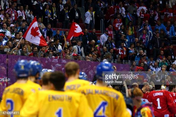 Canada fans celebrate following their team's 30 victory during the Men's Ice Hockey Gold Medal match on Day 16 of the 2014 Sochi Winter Olympics at...