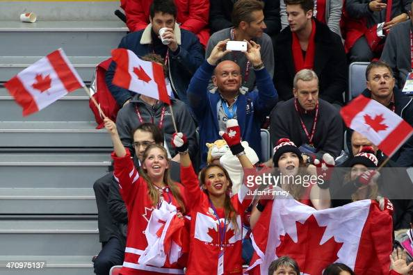 Canada fans cheer during the Men's Ice Hockey Semifinal Playoff against the United States on Day 14 of the 2014 Sochi Winter Olympics at Bolshoy Ice...