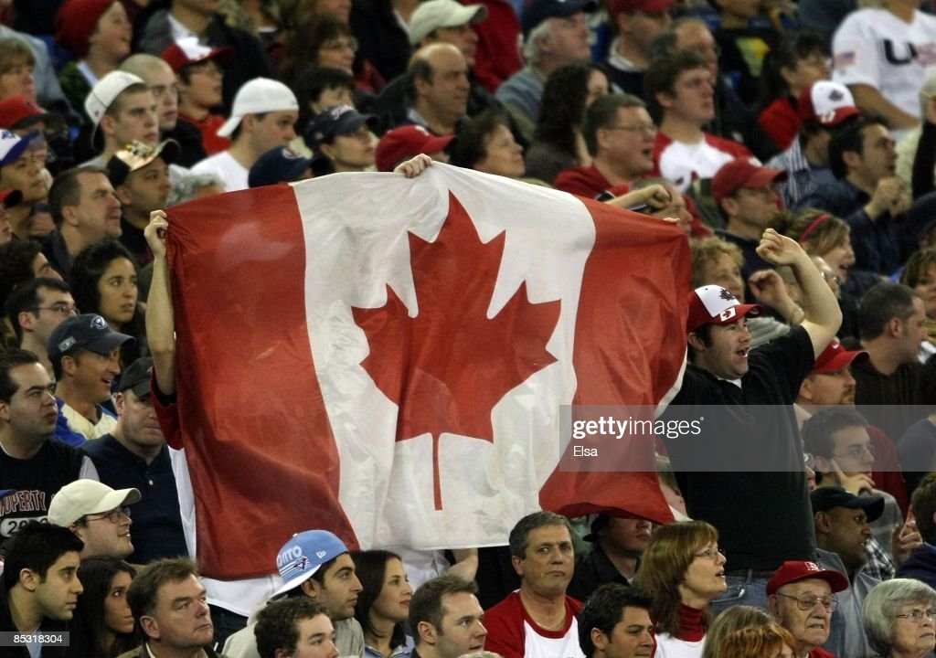 Canada fans wave the flag during the 2009 World Baseball Classic Pool C match on March 7, 2009 at the Rogers Center in Toronto, Ontario, Canada. The USA defeated Canada 6-5.